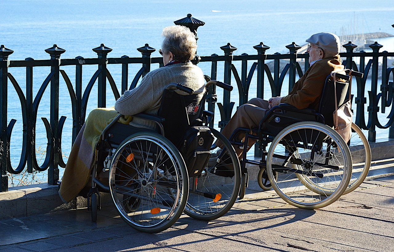 elderly couple with wheelchair